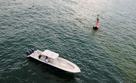 sport fishing: Sport fishing boat in the ocean with a  buoy