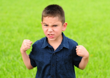 Young boy who is angry with his fists raised Stock Photo - 13979572