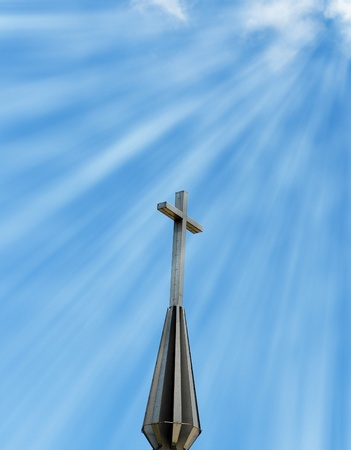 Concept of Sun rays shining down from heaven on a Christian cross photo