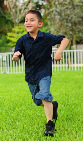 toothless: young boy getting exercise and smiling a toothless grin