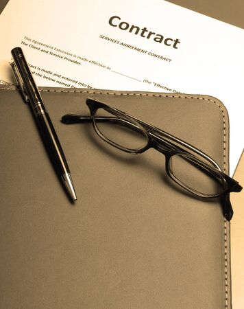 Reading over and a signing a business contract photo