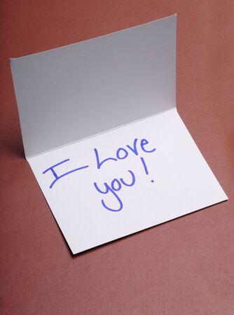 A handwritten note saying I love you Фото со стока