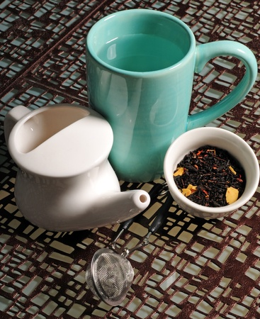 infuser: Neti pot for sinuses paired with hot tea make a perfect remedy when suffering from cold and flu Stock Photo
