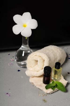 Essential oils and towels and frangipani flower photo