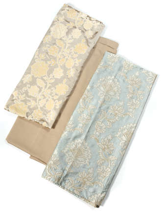 Rolls of three types of fabric used for interior design