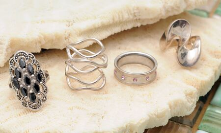 Rings or jewelry accessories in silver and white gold