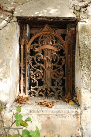 vintage decorative wrought iron on old building