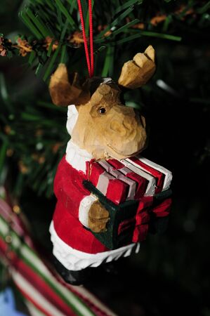 santa moose: Moose christmas ornament dressed as santa Stock Photo