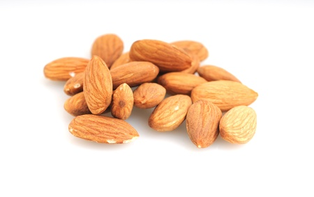 Raw almonds on a white background