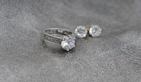 diamind jewelry consisting of engagement ring and earrings