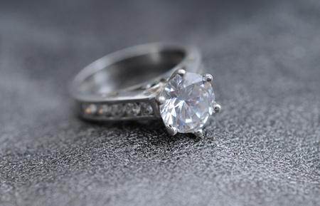 diamond ring on elegant gray leather background