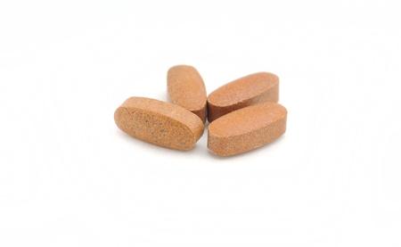 multi-vitamin supplements on white background Stock Photo
