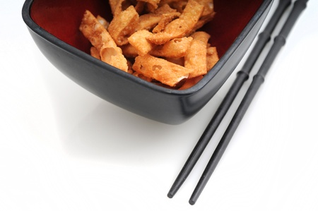 Fried wonton strips or Chinese food in bowl with chopsticks Stok Fotoğraf