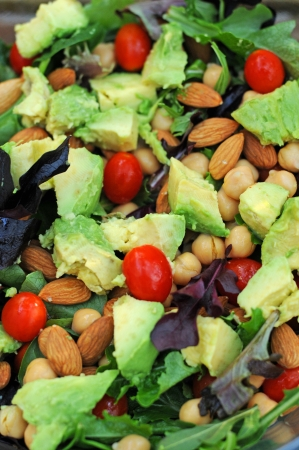 Close up of salad with vegetables and nuts Imagens