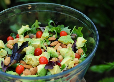 Mixed green salad with avocadoes, tomatoes, chickpeas and almonds