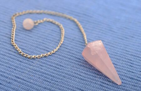 New age rose quartz crystal pendulum  photo