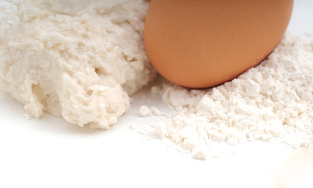 Baking ingredients with flour, eggs and dough Stock Photo