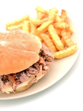 shredded pork sandwich and French fries photo