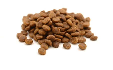 kibble: Dry pet food in kibble form on white background Stock Photo