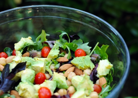 healthy vegan salad with avocados and vegetables