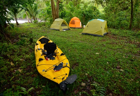 camping with three tents and a kayak near an ocean in panama  photo