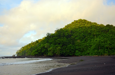 landscape of tropical hill with beach, rocks and ocean  photo