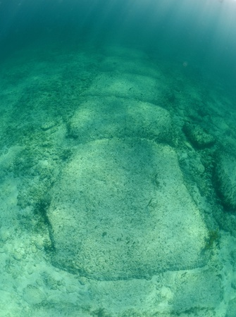 Underwater rock formation in the Bahamas named Bimini Road that is thought by some to be remnants of Atlantis