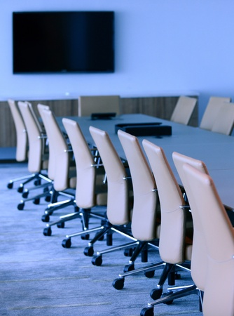 Boardroom meeting: executive boardroom in an office for business with nobody