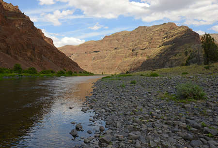 freshwater: John Day River in oregon with rocks, water and mountains