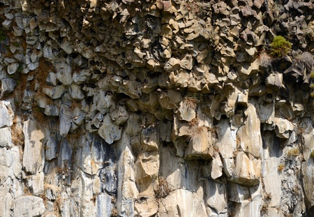 unusually: unusually shaped rocks on the side of a mountain for a textured nature background