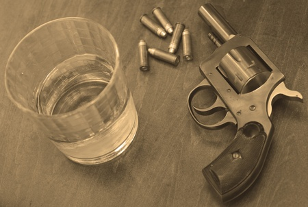bullets, booze and a gun for a deadly combination in sepia