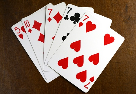 lucky 7 poker hand with three of a kind cards