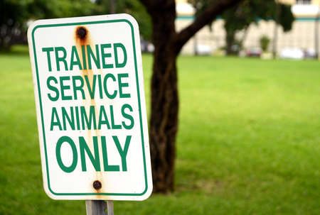 trained: trained service animals only sign at park in summertime