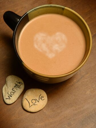 hot chocolate with heart in center of mug photo