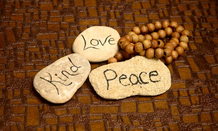 peaceful scene with rocks with words peace, love and kind for meditation photo