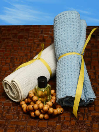 aromatherapy outdoors at spa with wash cloths and essential oil