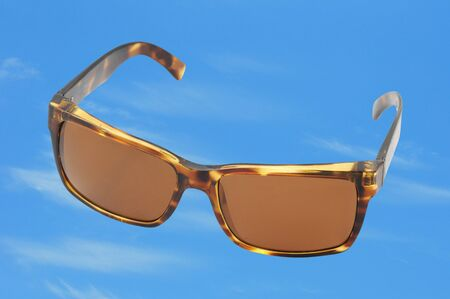 brown sunglasses for fashion on a bright blue sky Stock Photo