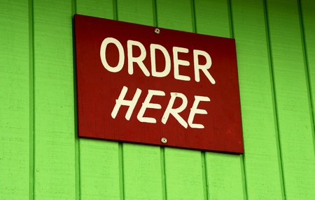 order here: order here sign on green wall