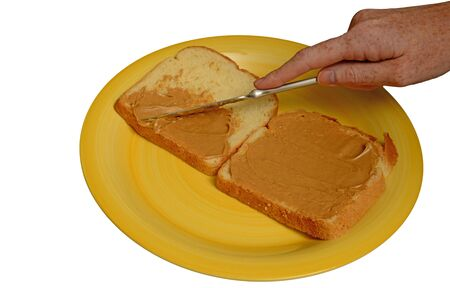 making a sandwich: making a sandwich and spreading peanut butter on bread with knife