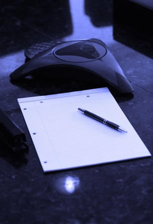 blank notebook with intercom for conference call and nobody Stock Photo