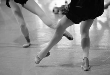 feet of girls dancing in ballet class  photo
