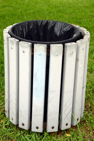 disposed: empty trash or garbage bin outdoors in summer Stock Photo