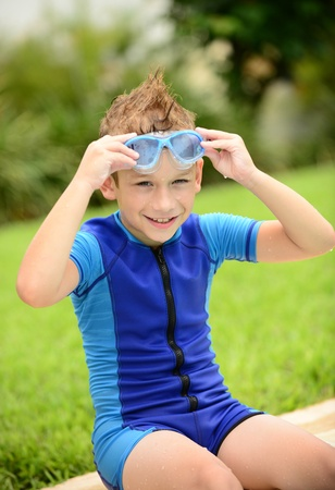 cute kid with goggles and wetsuit in summer photo