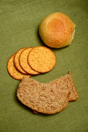 an assortment of breads, crackers and rolls for carb concept