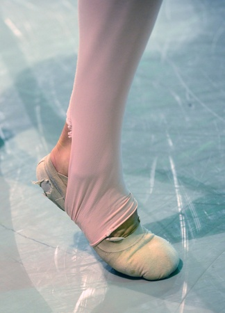 ballet dancer foot with worn out shoes photo