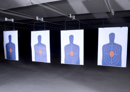 bullseye targets lined up at gun range