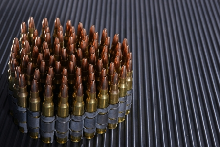 rifle bullets or ammunition on textured background Imagens