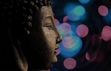buddha and abstract lights background