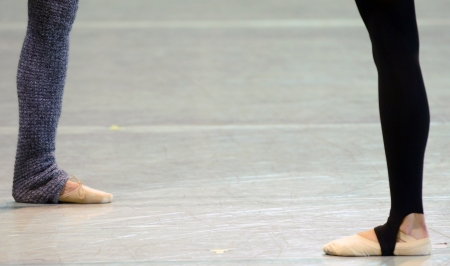 ballet dances wearing leg warmers with space for text Stock Photo