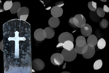 spooky headstone from graveyard on abstract background for halloween  photo
